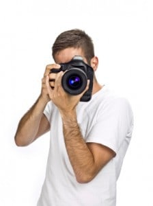 big camera hides mans face
