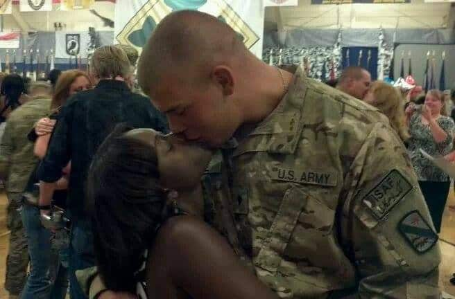 Our coming home kiss when my unit arrived home from Afghanistan – our first kiss in a year!
